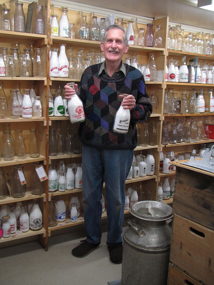 Dairy Bob Snyder with part of his collection of dairy artifacts