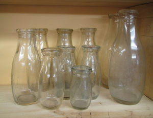 A group of empire style bottles: quart, pint and half-pint