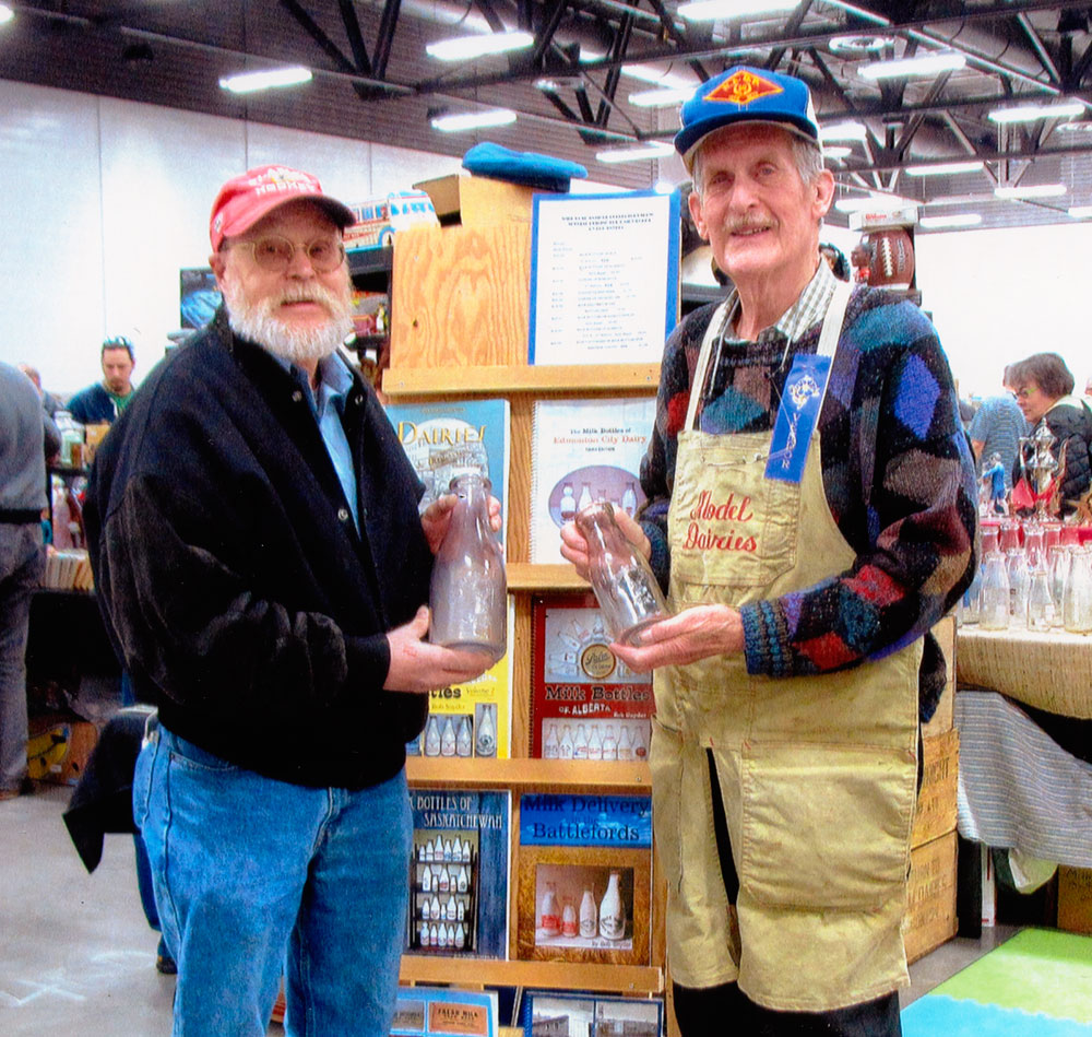 Ken Porter and Bob Snyder at the 2015 Wildrose Antique Show with their rare Hepworth and Trimble milk bottles.